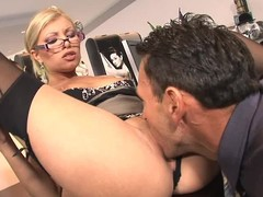 Long legged glassed office blonde Donna Siren in black nylons and bumptious heels gets will not hear of hot pussy eaten and fucked on the desk by horny boss. This four-eyed dream babe loves hardcore sex at work!