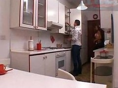 Shemale sex in a kitchen