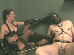 A dude almost a mask gets ridden by his unsightly bit of skirt
