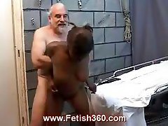 Ebony slut gets her ass spread with an anal speculum and banged by an old ivory dick