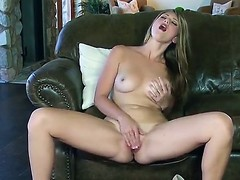 Mesmeric hottie with large melons Shae Snow loves to seem to be her yummy mooist pussy on a couch