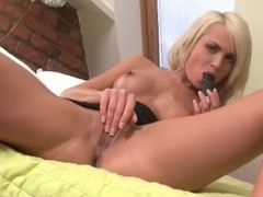 Leggy blonde in high heels masturbates solo