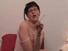 Brunette in sheer lingerie smokes grow faint