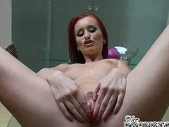 Sensational redhead pornstar Claudia Adams spreads will not hear of long legs wide open increased by masturbates wet cooshie